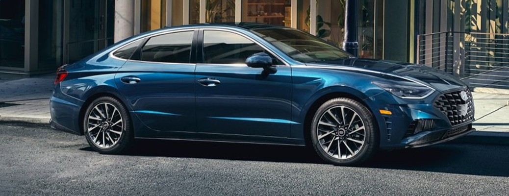 A blue-colored 2021 Hyundai Sonata parked on the side of a street