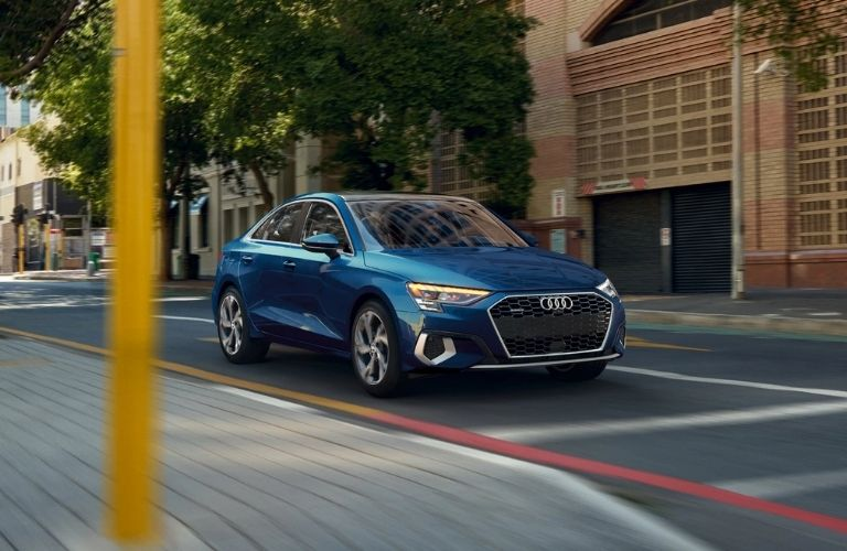 Audi A3 moving fast on a road