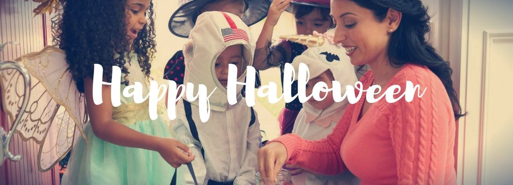 happy Halloween written in white against a backdrop of a lady handing out candy to trick or treaters