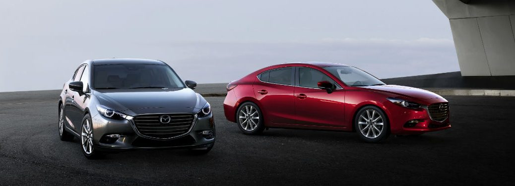 two 2018 Mazda3 models parked next to each other