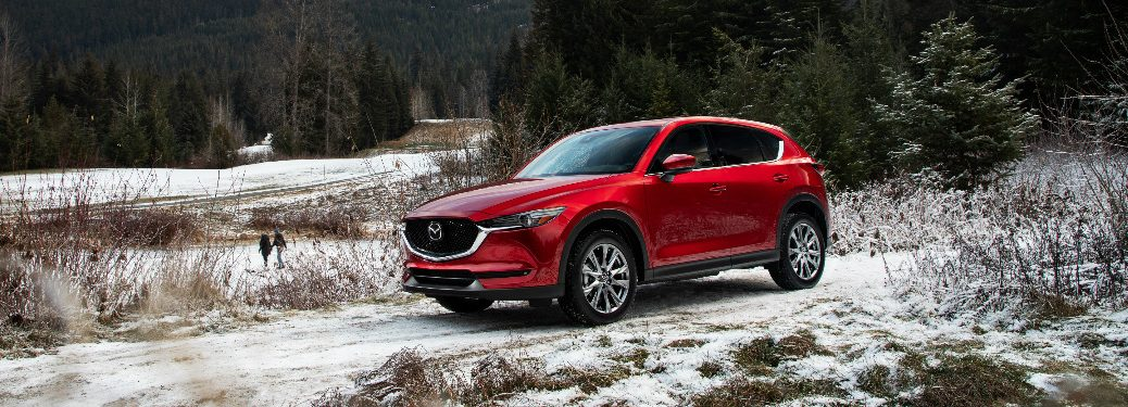 Red 2019 Mazda CX-5 parked on a snowy road
