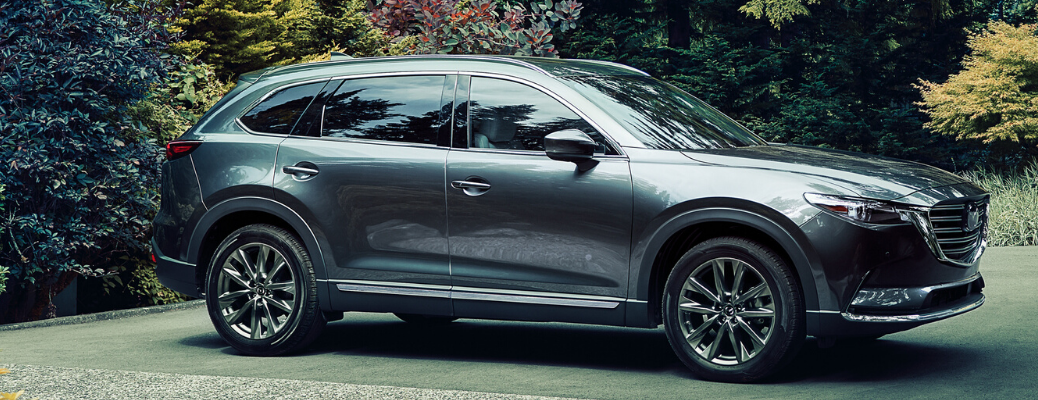 Side view of gray metallic 2020 Mazda CX-9 parked on a garden