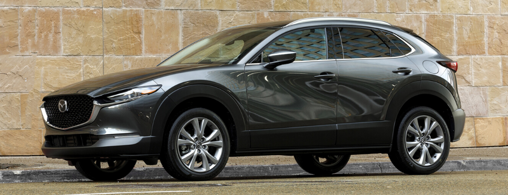 Side view of Polymetal Gray Metallic 2020 Mazda CX-30 parked on the street