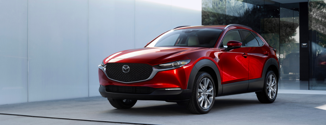 Front view of red 2020 Mazda CX-30 parked in front of house