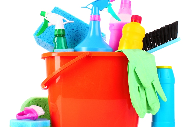 Bucket with many different cleaning products