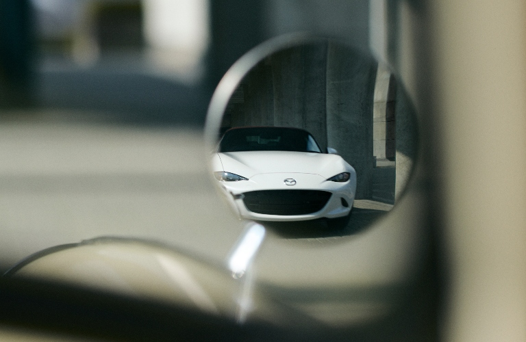 Mazda 100th Anniversary Edition Series viewed in the mirror