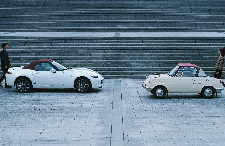 Mazda 100th Anniversary Edition Series with two people walking in the background