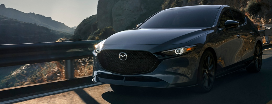 2021 Mazda3 Hatchback driving through the mountains