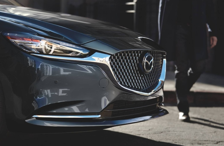 2021 Mazda6 front grille with person walking past