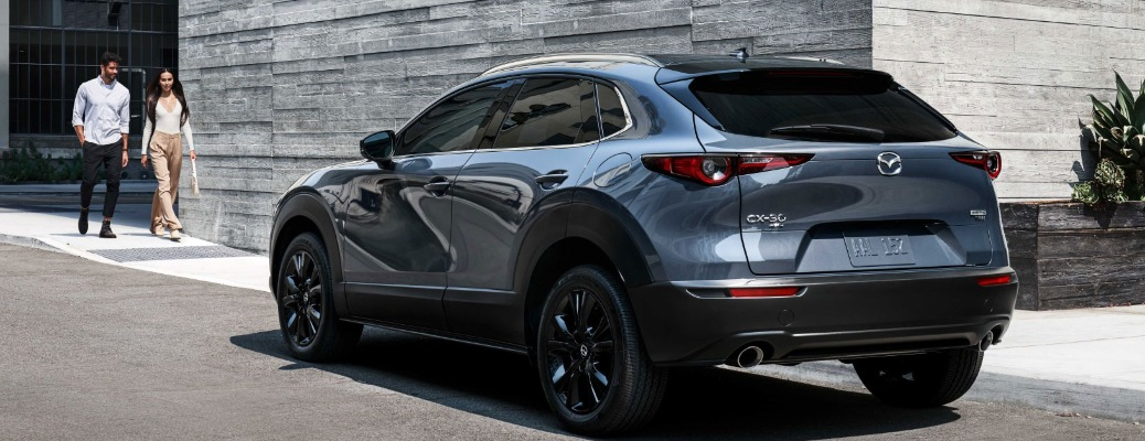 Two people walking up to the 2021 Mazda CX-30
