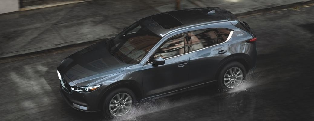 2021 Mazda CX-5 racing through the waters in the road
