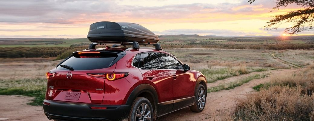 Back view of the 2021 Mazda CX-30 carrying luggage on top