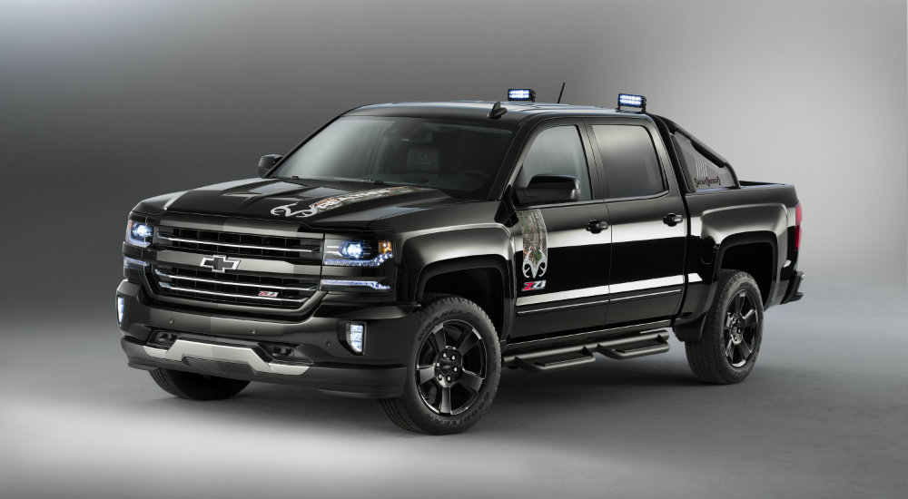 2016 Chevy Silverado Realtree Edition on grey background