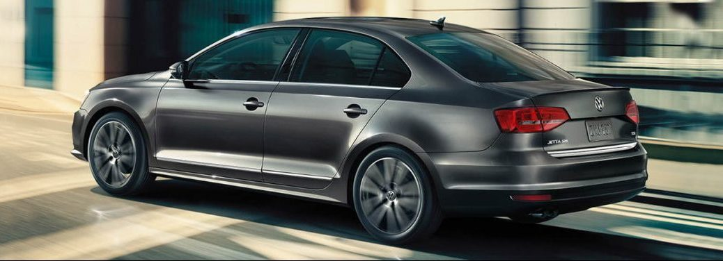 2018 Volkswagen Jetta profile view driving in a city