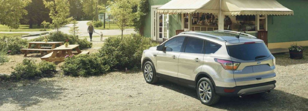 2018 Ford Escape parked in the country by a shop