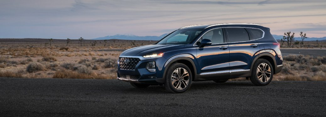 side view of blue 2019 santa fe in empty field