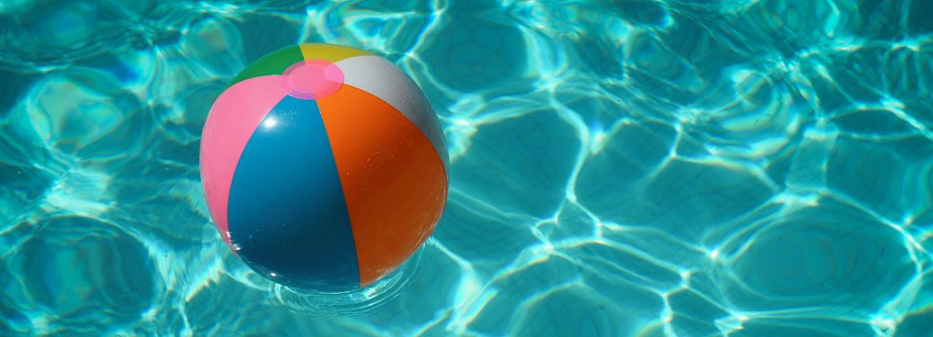 pool water with beach ball floating in it