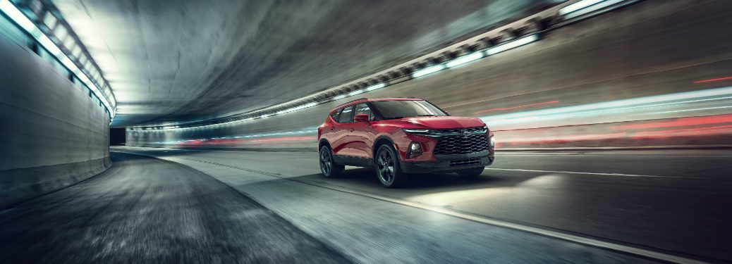 red 2019 chevy blazer driving through tunnel at night