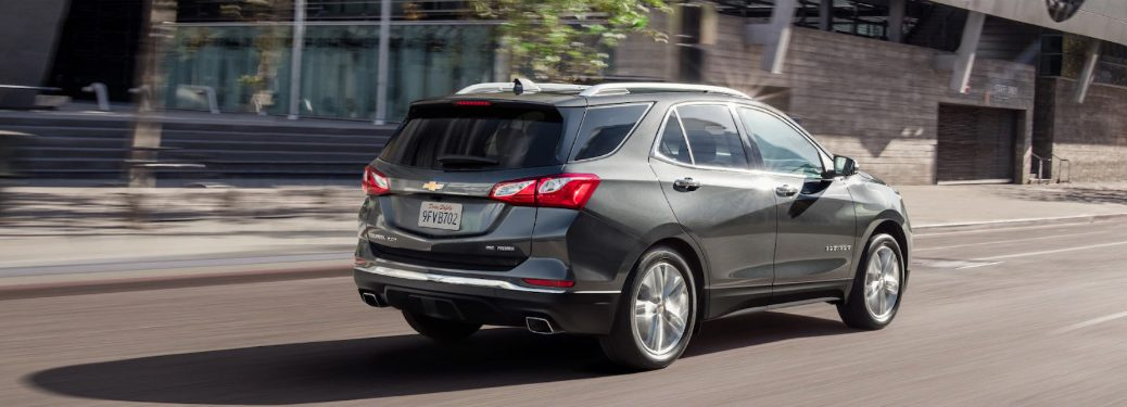 rear view of gray 2019 chevy equinox driving on city road