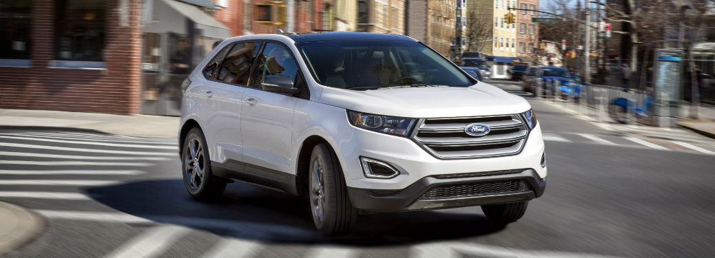 front and side view of white 2018 ford edge