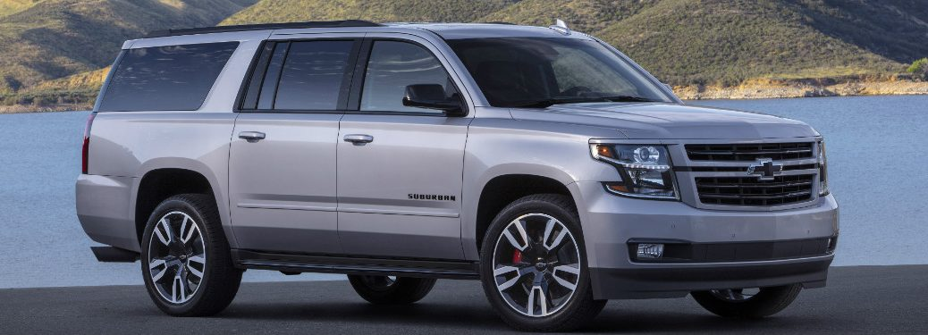 front and side view of silver 2019 chevrolet suburban