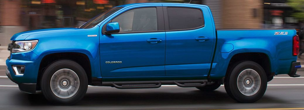side view of blue 2019 chevrolet colorado