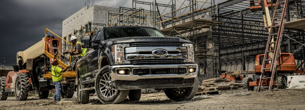 front view of black 2019 ford super duty at construction site