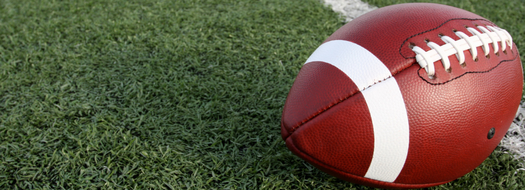 close up of football on football field