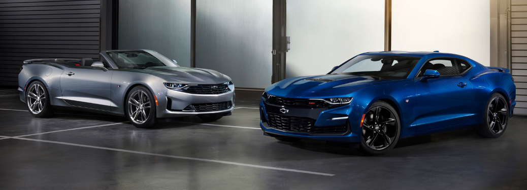 side view of silver 2019 chevy camaro ss convertible and blue 2019 chevy camaro ss coupe