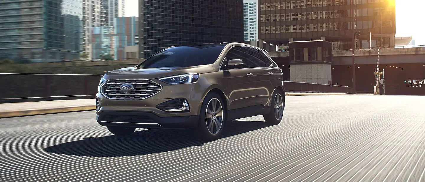 2019 Ford Edge Exterior Driver Side Front Profile in Stone Gray