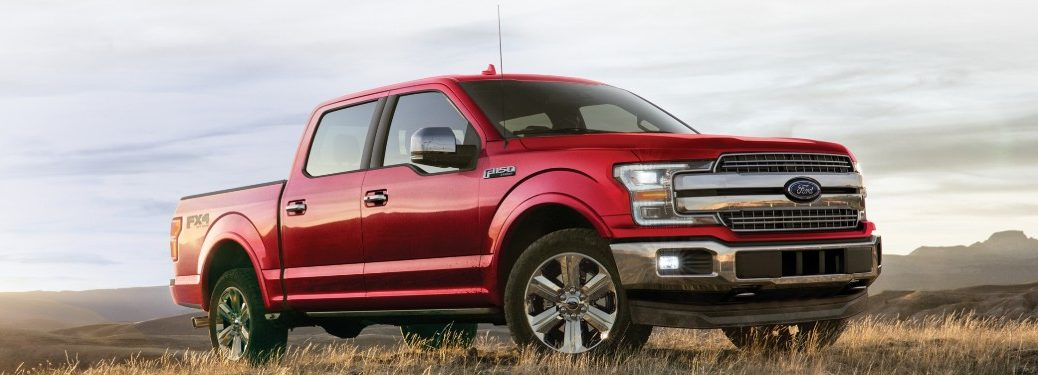 Front passenger angle of a red 2020 Ford F-150 parked outdoors