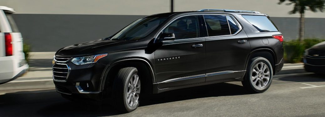 Front driver angle of a black 2020 Chevrolet Traverse pulling out of a parking spot
