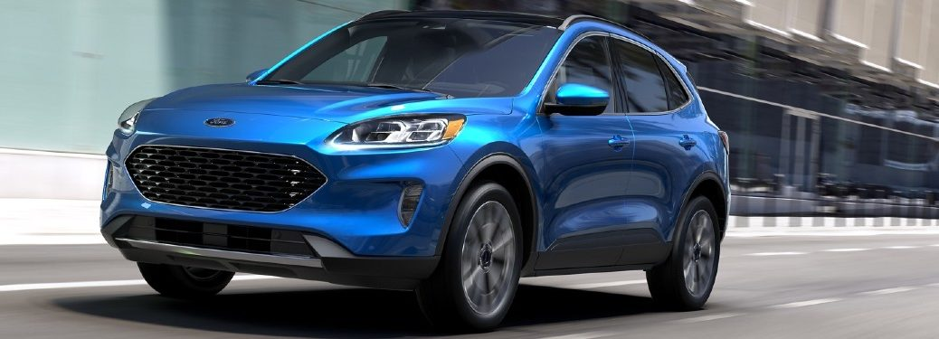 Front driver angle of a blue 2020 Ford Escape driving on a road