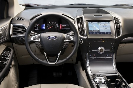 Steering wheel and touchscreen inside the 2020 Ford Edge