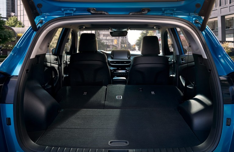 Rear angle of the cabin of the 2020 Hyundai Tucson with the rear seats put down