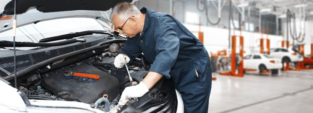 Mechanic working on the engine of a car