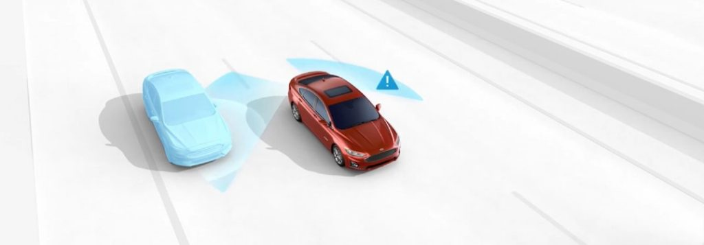 Red 2020 Ford Fusion using the Blind Spot Information System feature