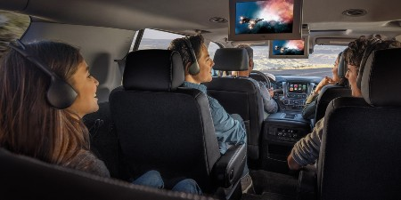 Happy passengers sitting inside the 2020 Chevrolet Suburban