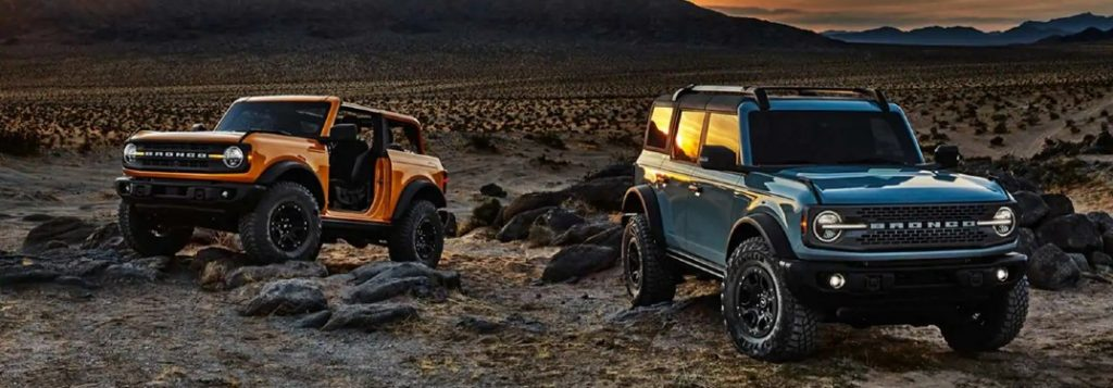 Two 2021 Ford Bronco vehicles parked off-road