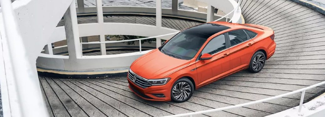 Front driver angle of an orange 2021 Volkswagen Jetta