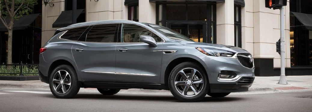 Front passenger angle of a grey 2021 Buick Enclave