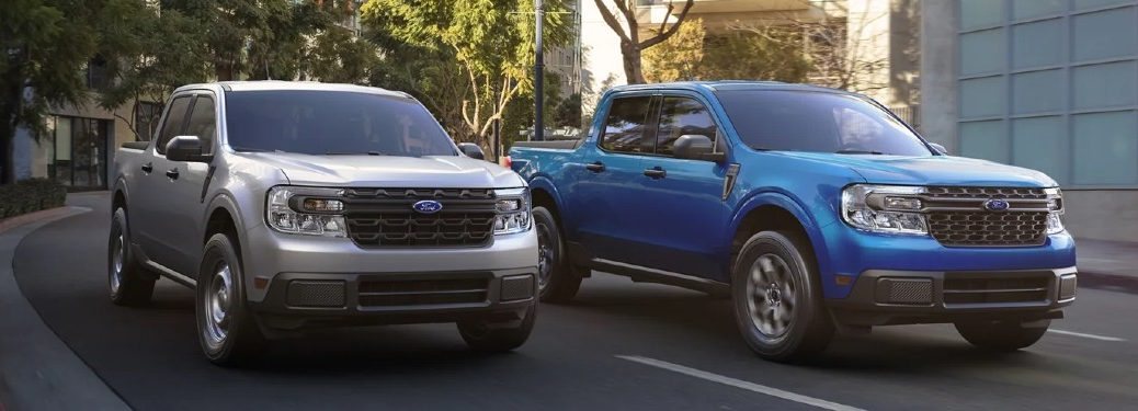 Two 2022 Ford Maverick trucks driving by each other