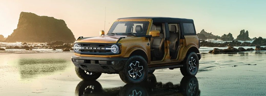 Front driver angle of an orange 2021 Ford Bronco