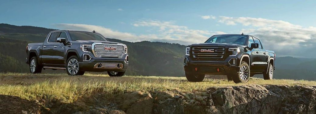 Two 2021 GMC Sierra 1500 vehicles parked near each other