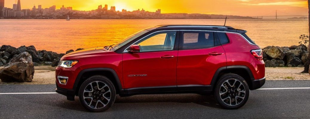 Red 2019 Jeep Compass at sunrise/sunset