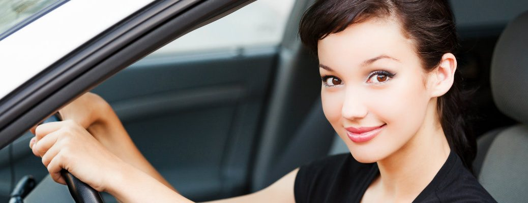 Woman behind the wheel of a new vehicle