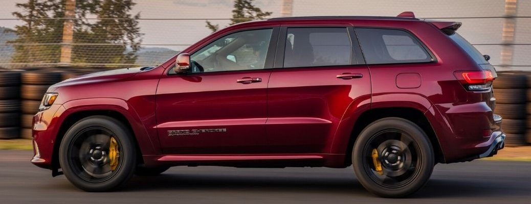 Side profile of a red 2020 Jeep Grand Cherokee