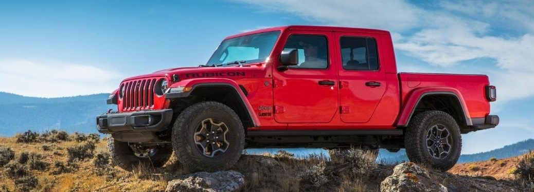 Red 2021 Jeep Gladiator Rubicon EcoDiesel Side Exterior on Rocky Trail
