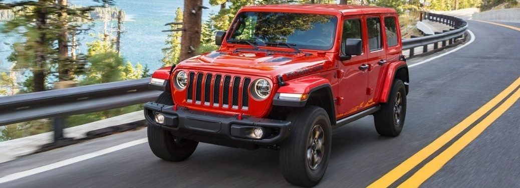 Red 2021 Jeep Wrangler on a Coast Road