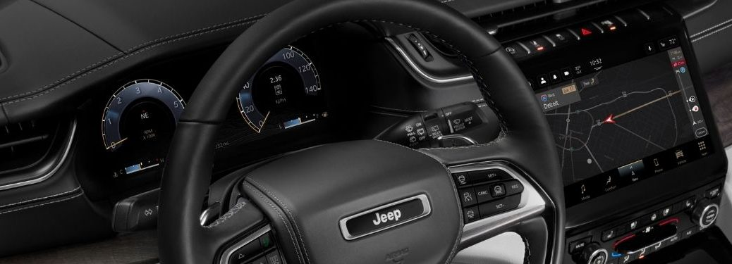 Close Up of 2021 Jeep Grand Cherokee L Steering Wheel and Uconnect 5 Touchscreen Display